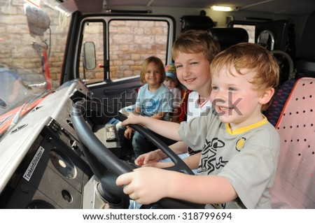 Frankfurt, Germany - May 2, 2009 - Kids sitting in a fire truck in a open house day playing fire figthers - stock photo