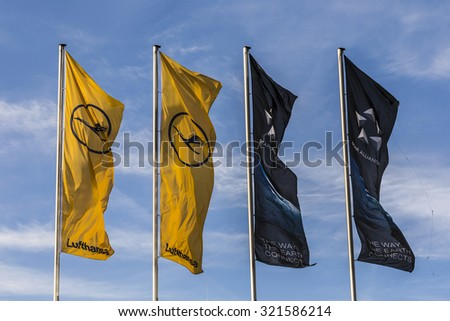 FRANKFURT, GERMANY - MAY 18, 2015: Lufthansa flag with Lufthansa symbol, the crane in Frankfurt, Germany. The aktual Lufthansa Logo is a design from 1964. - stock photo