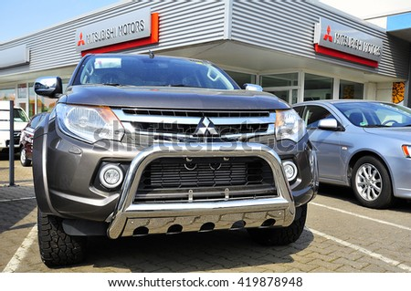 FRANKFURT,GERMANY-MAY 13:Mitsubishi Motors car in the blue sky on May 13,2016 in Frankfurt, Germany.Mitsubishi Motors is a multinational automotive manufacturer headquartered in Minato, Tokyo, Japan.