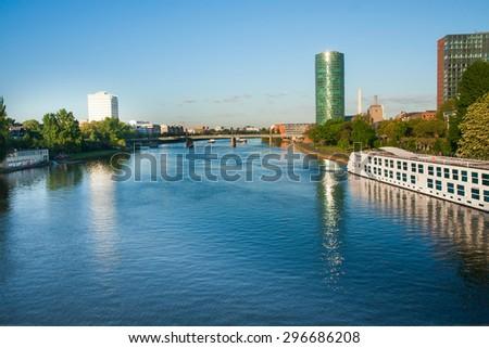 FRANKFURT,GERMANY 5 MAY 2015: Modern tubular tower building near the river - stock photo