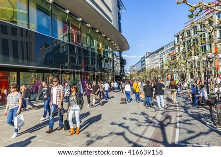 FRANKFURT, GERMANY - MAY 6, 2016: people walk along the Zeil in Midday in Frankfurt, Germany. Since the 19th century it is of the most famous and busiest shopping streets in Germany. - stock photo