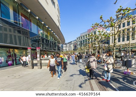 FRANKFURT, GERMANY - MAY 6, 2016: people walk along the Zeil in Midday in Frankfurt, Germany. Since the 19th century it is of the most famous and busiest shopping streets in Germany.