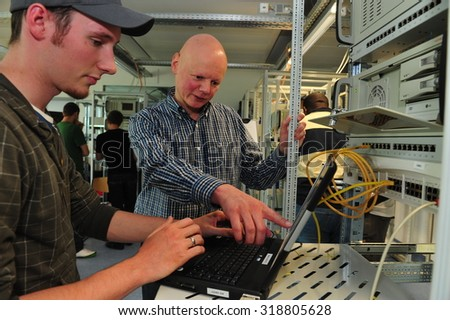 Frankfurt, Germany - May 6, 2009 - Student and teacher at Goethe-University solving network problem - stock photo