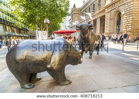 FRANKFURT, GERMANY - MAY 16, 2014: The Bull and Bear Statues at the Frankfurt Stock Exchange in Frankfurt, Germany. Frankfurt Exchange is the 12th largest exchange by market capitalization.