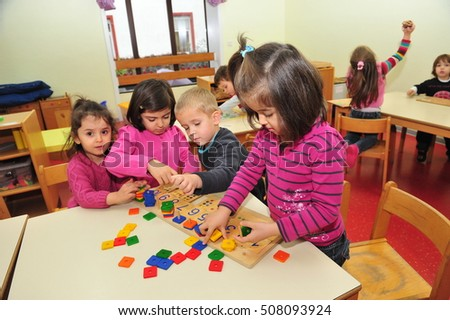 Frankfurt, Germany - November 25, 2011- Refugee children with migration background playing in school. Germany is forced to invest in education
