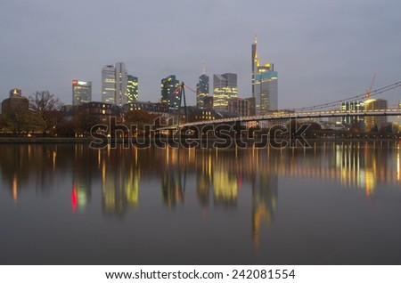 FRANKFURT, GERMANY, NOVEMBER 14, 2014: Skyline of skyscrapers in frankfurt is being reflected on the surface of main river.