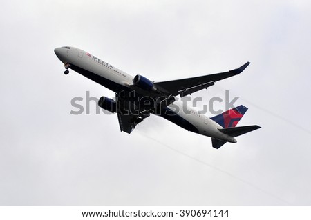 FRANKFURT,GERMANY-OCT 08:airplane of Delta Air Lines above the Frankfurt airport on October 08,2015 in Frankfurt,Germany.Delta Air Lines, Delta short, is an American airline based in Atlanta.