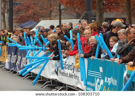 FRANKFURT, GERMANY - OCTOBER 30: Group of spectators watch the BMW Frankfurt Marathon, October 30, 2011 in Frankfurt, Germany. - stock photo