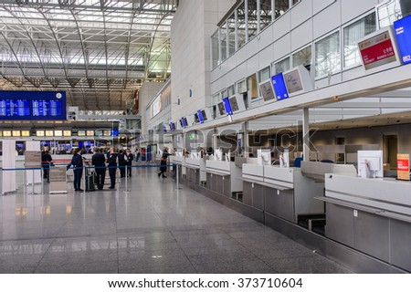 Frankfurt, Germany- 26 October 2015:Passengers waiting in a departures hall at an airport or train station standing in line ready to board their plane, travel concept - stock photo