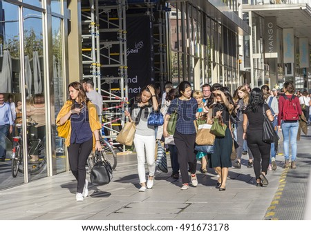 FRANKFURT, GERMANY - SEP 29, 2016: people walk along the Zeil in Midday in Frankfurt, Germany. Since the 19th century it is of the most famous and busiest shopping streets in Germany.