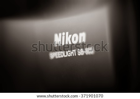 FRANKFURT, GERMANY - SEPT 19, 2011: Focusing technique effect over the Nikon Speedlight professional light flash. Nikon is a Japanese multinational corporation headquartered in Tokyo, Japan