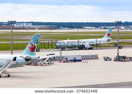 FRANKFURT, GERMANY - September 25, 2015: Air Canada plane seen parked at the tarmac of  Frankfurt International Airport - stock photo