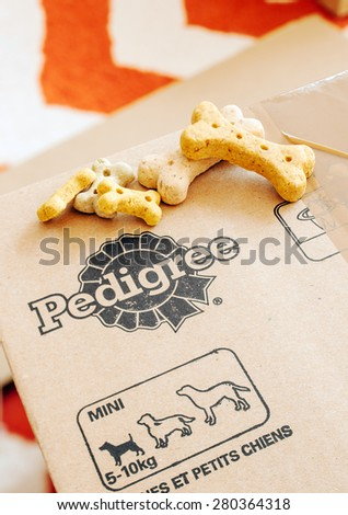 FRANKFURT, GERMANY - SEPTEMBER 20, 2014: Box of Pedigree Petfoods with dog food on top. Pedigree is a subsidiary of the American group Mars specializing in pet food, with factories in England - stock photo