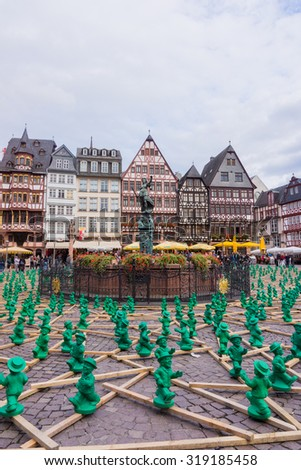 FRANKFURT, GERMANY - SEPTEMBER 19, 2015: figures from Ottmar Hoerl to celebrate the 25th anniversary of Germanys reunion in Frankfurt, Germany on public places.