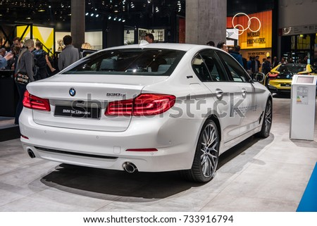 Frankfurt, Germany, September 13, 2017: white BMW 530e plug-in hybrid at 67th International Motor Show (IAA), electric
