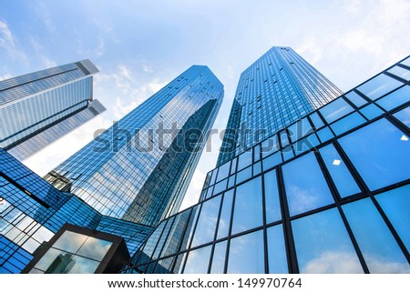 FRANKFURT - JULY 4: Bottom view of Deutsche Bank Twin Towers on July 4, 2013 in the central business district of Frankfurt am Main, Germany. Frankfurt is the largest financial centre in Europe. - stock photo