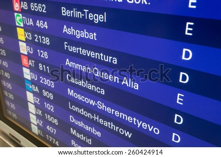 FRANKFURT MAIN - DEC 6: Departure board with destination airports in Frankfurt Main. December 6, 2014 in Frankfurt Main, Germany - stock photo