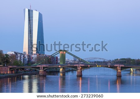 FRANKFURT MAIN, GERMANY - APR 18: New European Central Bank (ECB) building and river Main bridges in Frankfurt. April 18, 2015 in Frankfurt Main, Germany - stock photo