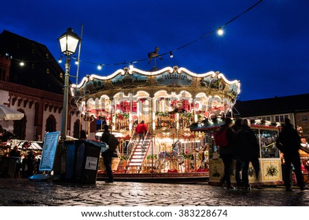FRANKFURT - November 28 2015: People visit traditional christmas market and  carousel in Frankfurt, Germany.  First Christmas market was held in Frankfurt in 1393.