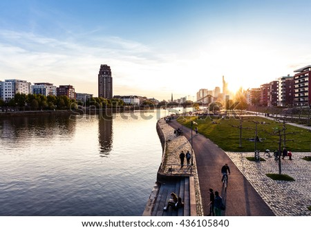 Frankfurt promenade on the Main river during sunset