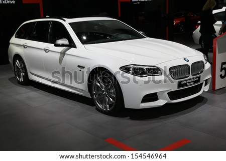 FRANKFURT - SEPT 10: BMW M 550d xTrive Touring shown at the 65th IAA (Internationale Automobil Ausstellung) on September 10, 2013 in Frankfurt, Germany. - stock photo