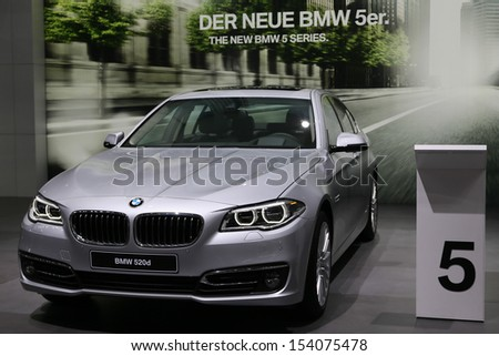 FRANKFURT - SEPT 10: BMW 5 Series 520d shown at the 65th IAA (Internationale Automobil Ausstellung) on September 10, 2013 in Frankfurt, Germany. - stock photo