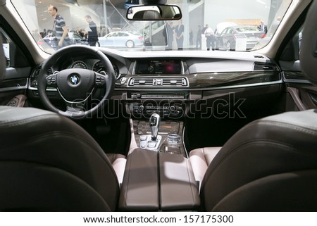 FRANKFURT - SEPT 10: Cockpit of BMW 5 Series shown at the 65th IAA (Internationale Automobil Ausstellung) on September 10, 2013 in Frankfurt, Germany. - stock photo