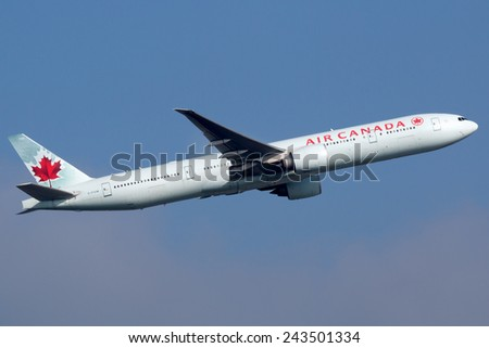 FRANKFURT - SEPTEMBER 17: Air Canada Boeing 777 aircraft taking off on September 17, 2014 in Frankfurt. Air Canada is the Canadian flag carrier and largest airline with some 172 planes. - stock photo