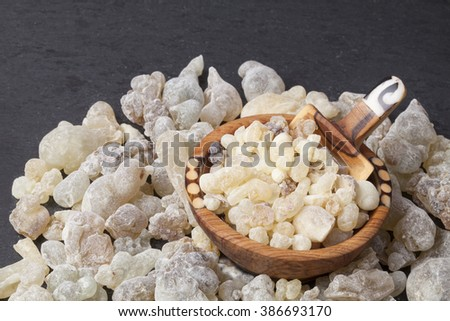 Frankincense is an aromatic resin, used for religious rites, incense and perfumes.  - stock photo