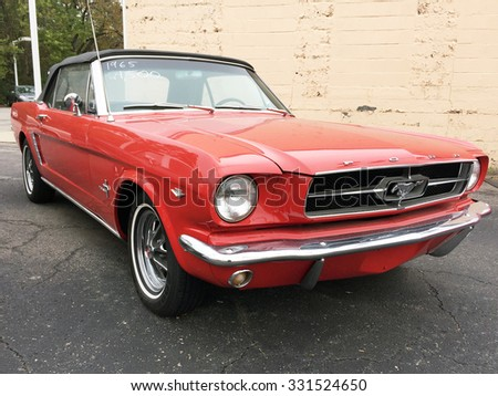 FRANKLIN, TN-OCTOBER, 2015: Focus is on the front end of this classic 1965 Mustang convertible. - stock photo