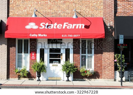 FRANKLIN, TN-OCTOBER, 2015:  Typical small town State Farm Insurance office set in an older strip of shops and businesses. - stock photo