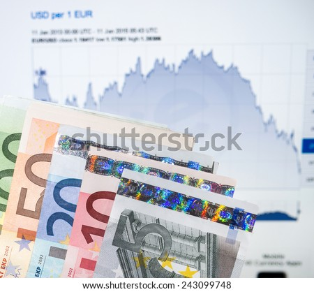 FRANKURT, GERMANY - JANUARY 11, 2015: The Euro currency continues to fall against the US dollar and is predicted to continue so as the U.S. economy continues to show strong growth. - stock photo