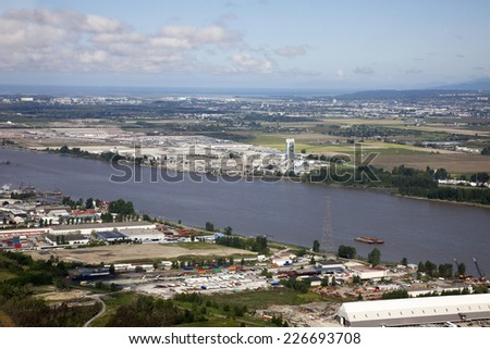Fraser River and field of Richmond, British Columbia, Canada - stock photo