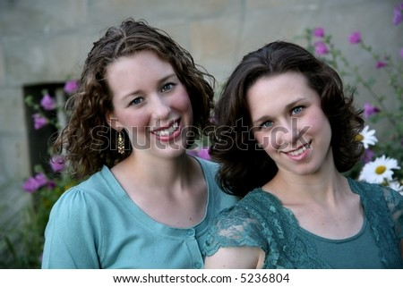 fraternal twins in senior picture - stock photo