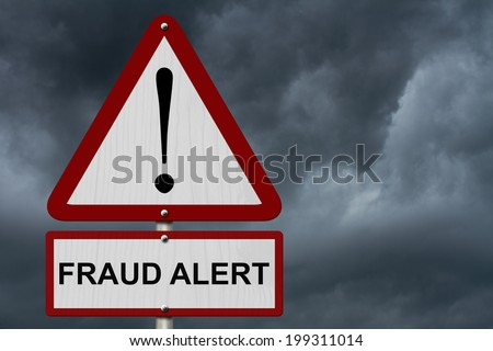 Fraud Alert Caution Sign, Red and White Triangle Caution sign with words Fraud Alert with stormy sky - stock photo