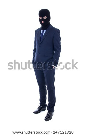 fraud concept - man in business suit and black mask isolated on white background - stock photo