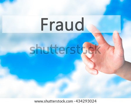 Fraud - Hand pressing a button on blurred background concept . Business, technology, internet concept. Stock Photo