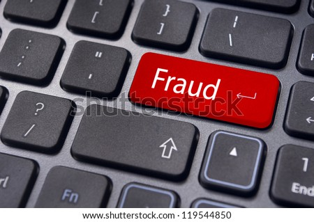 fraud, internet crime, with a message on enter key of computer keyboard. - stock photo