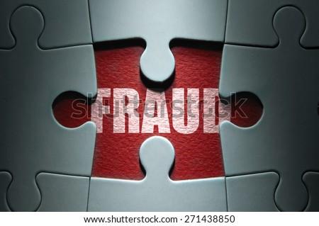 Fraud puzzle concept - stock photo