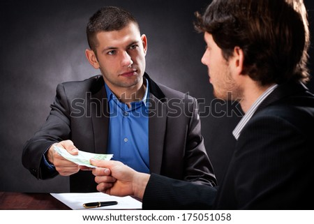 Fraud taking a money from man for a fake investment - stock photo