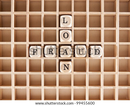 Fraud word construction with letter blocks / cubes and a shallow depth of field - stock photo