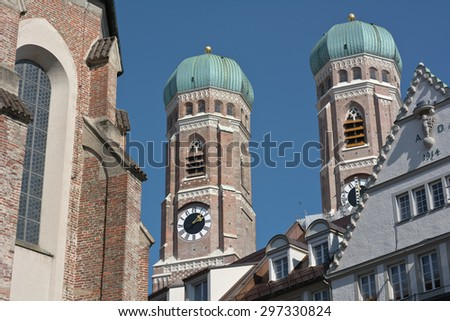 Frauenkirche and Surrounding Buildings in Munich - stock photo