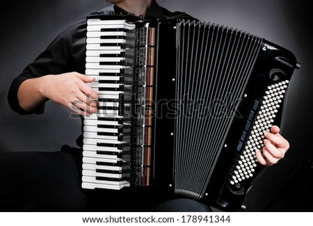 frayed keys of  accordion - stock photo