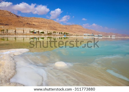 Freakish patterns of the evaporated salt in the Dead Sea. Salt formed long paths with scalloped edges. Israel in October - stock photo