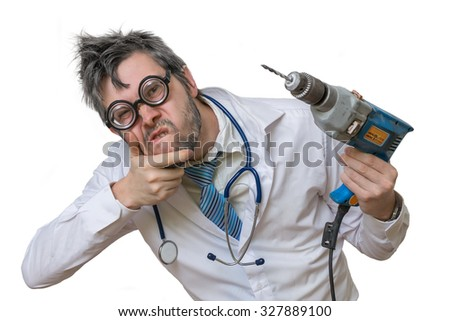 Freaky unsure mad dentist doctor with drill in hand isolated on white background. - stock photo