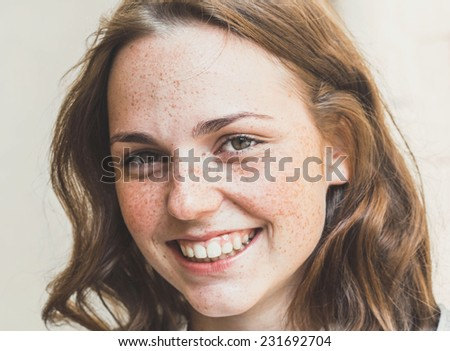 freckled hipster young beautiful woman street portrait