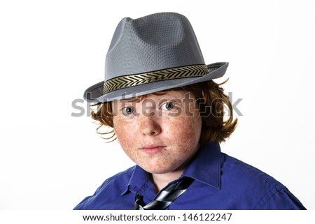 Freckled red-hair boy portrait in hat. Teenager age.
