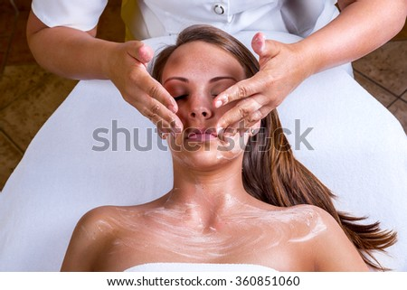 Freckles woman having a cosmetic treatment at the beauty salon. - stock photo