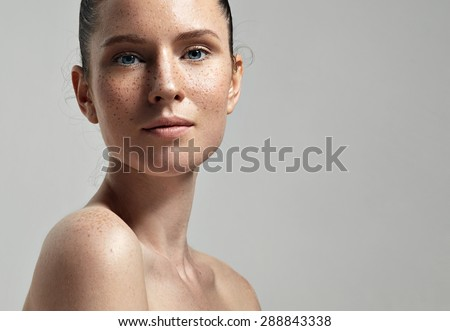 freckles woman's face portrait with healthy skin  - stock photo