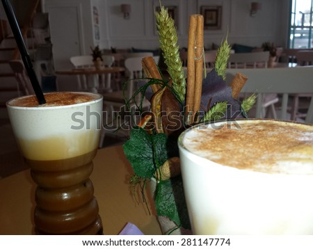 Freddo (cold) cappuccinos with muffins - stock photo